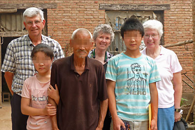 Judy, Linda, and Bob visiting with orphans in Henan Province.